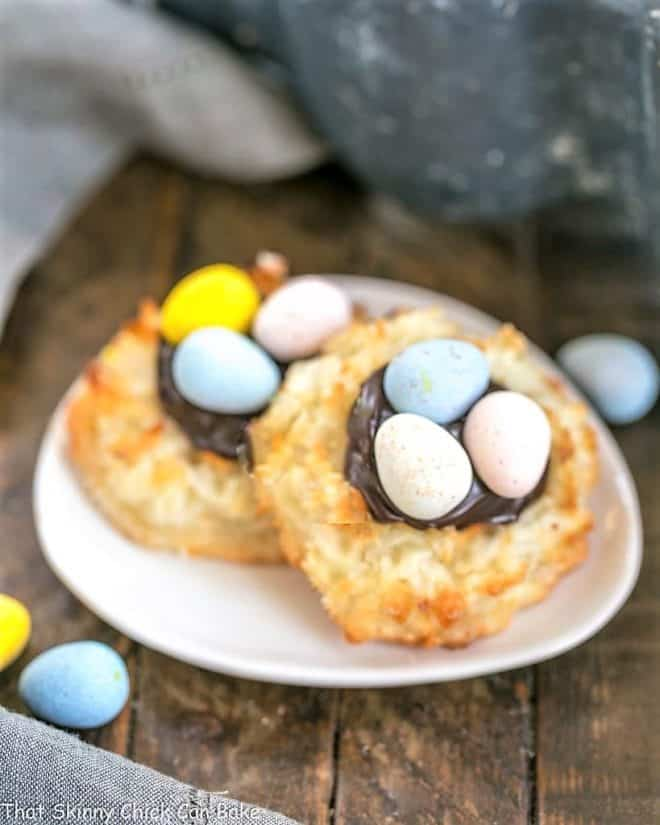 Two Coconut Macaroon Easter Nests on a small oval dish