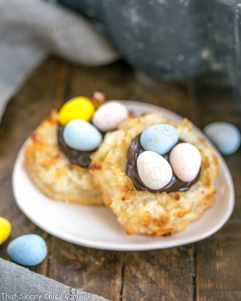Coconut Macaroon Easter Nests filled with fudge sauce and topped with chocolate eggs! #coconut #cookies #macaroons