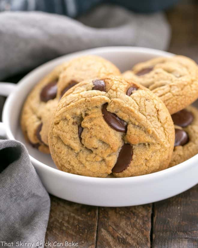 Close view of Brown Butter Chocolate Chip Cookies in a white dish with handles