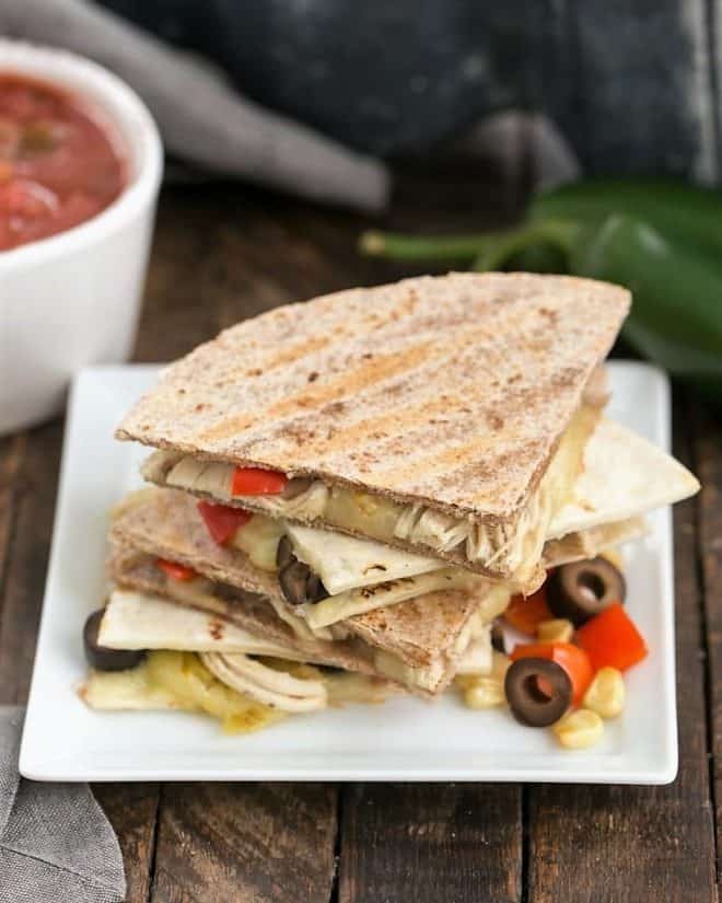 Cheesy Chipotle Chicken Quesadillas on a square white ceramic plate