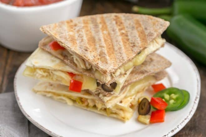 Chipotle Chicken Quesadillas cut in wedges and stacked on plate