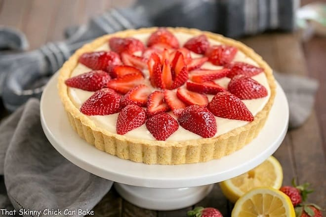 Strawberry Lemon Tart with lemon halves and whole strawberries
