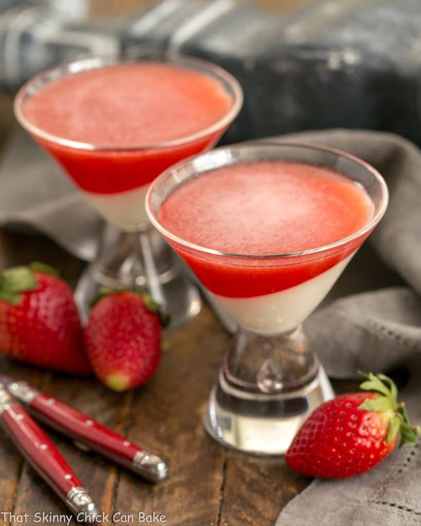 Two Vanilla Panna Cotta with Strawberry Gelée in martini glasses