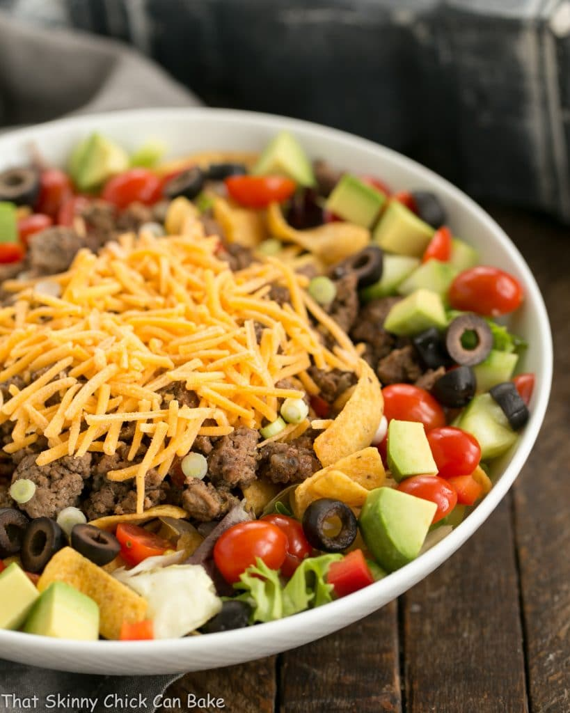 Beef Taco Salad with Salsa Dressing in a white ceramic bowl