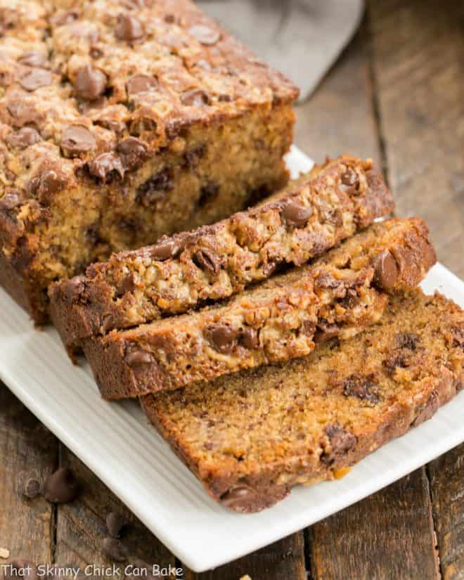 Chocolate Chip Toffee Banana Bread sliced on a white platter