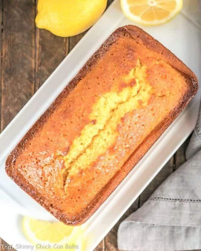 Glazed Lemon Pound Cake overhead loaf view on a white tray