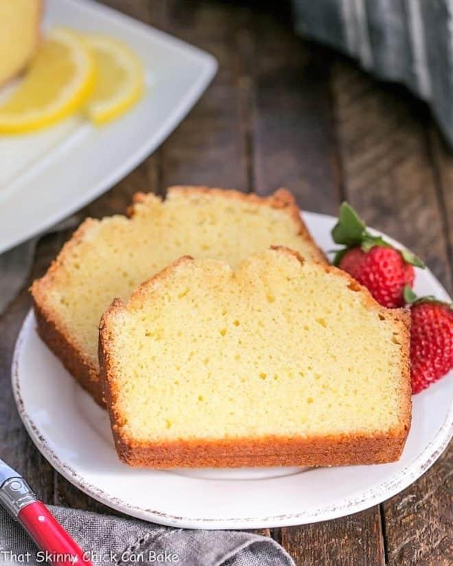 Glazed Lemon Pound Cake slices garnished with berries
