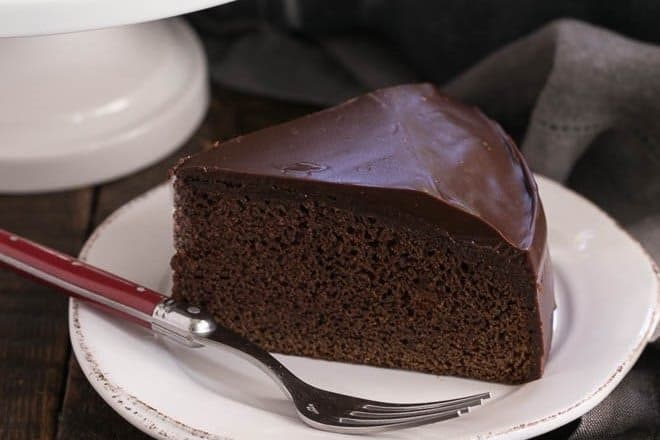 One Layer Chocolate Cake Recipe slice on a white plate