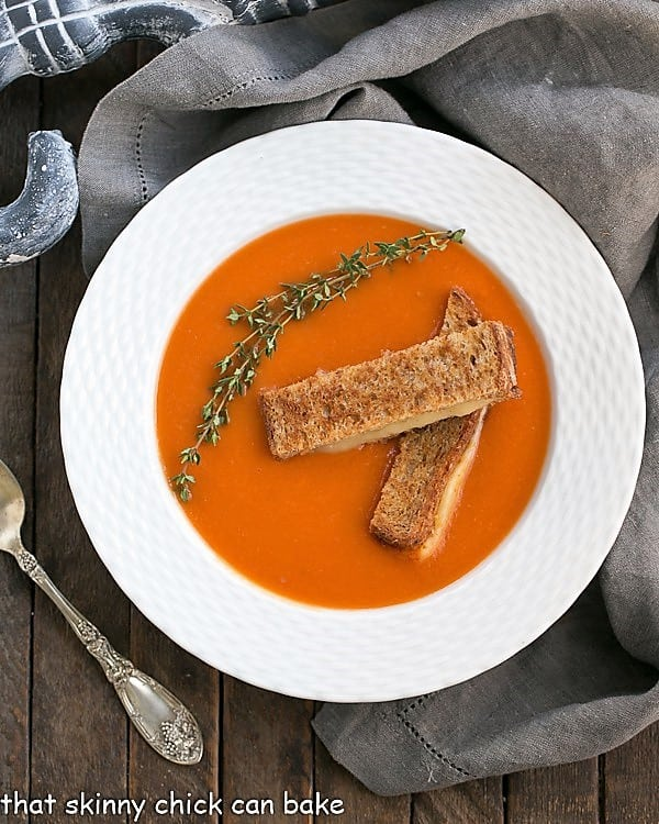 Thyme Kissed Tomato Soup in a white bowl overhead view