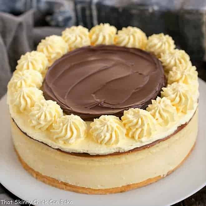 Boston Cream Pie Cheesecake on a white serving plate