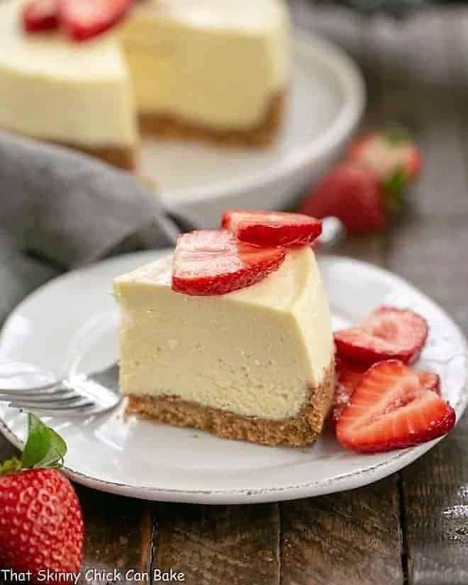 Slice of Vanilla Bean Instant Pot Cheesecake slice on a dessert plate