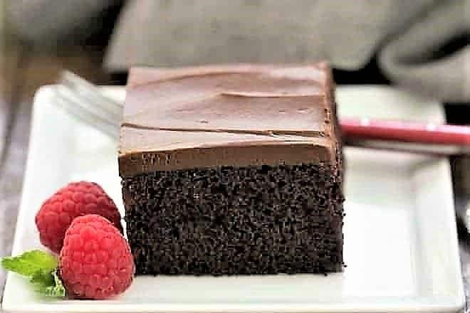 Black Magic Snack Cake slice on a square white plate