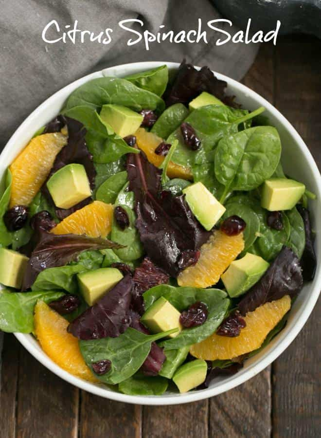 A tasty Citrus Spinach Salad with Avocados and Oranges and a lovely citrus Dijon vinaigrette #spinachsalad #citrus #oranges