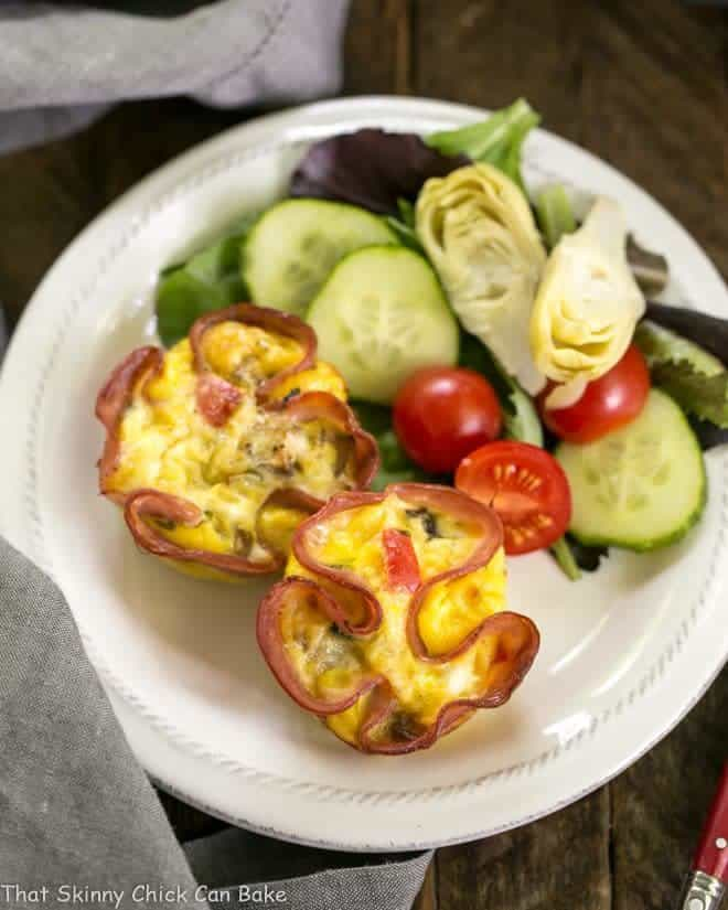 Overhead view of Egg Muffins in Ham Cups on a small white plate