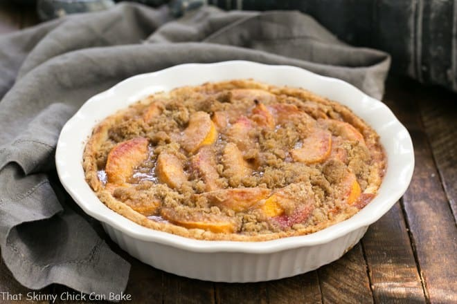 Easy Peach Crumb Pie - Juicy peaches baked in a buttery pastry with a crumb topping