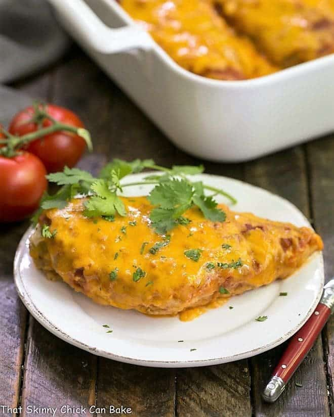 Easy Salsa Chicken on a small white plate with casserole in the background