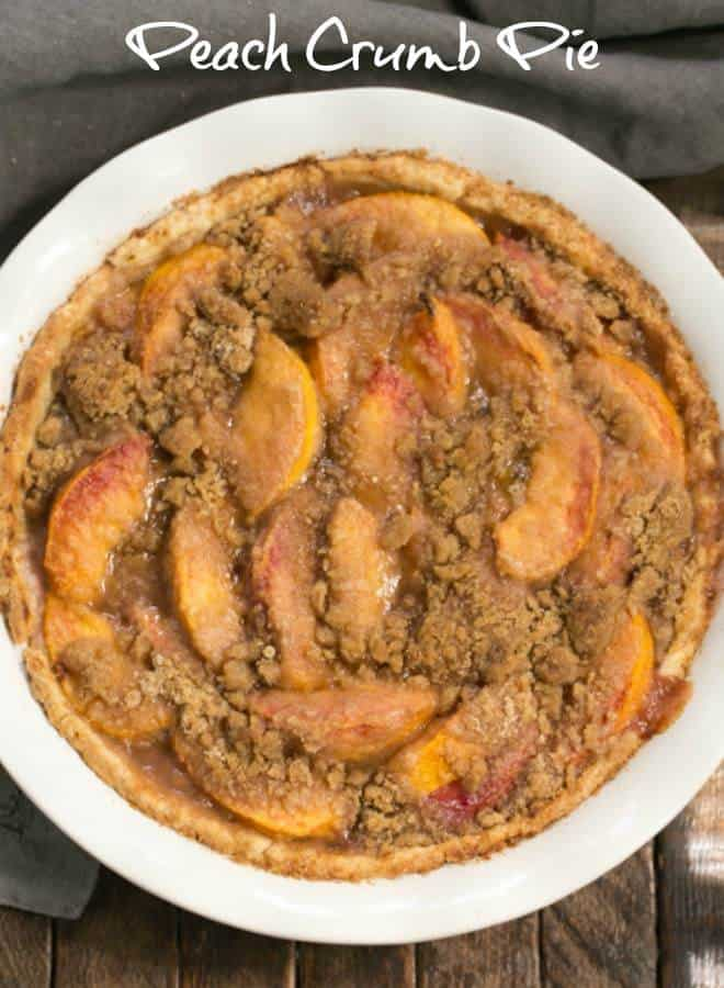 Easy Peach Crumb Pie - Juicy peaches baked in a buttery pastry with a crumb topping #peaches #peachpie #summerdessert #crumbtopping