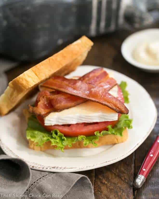 Brie Bacon Lettuce and Tomato Sandwich on a white plate