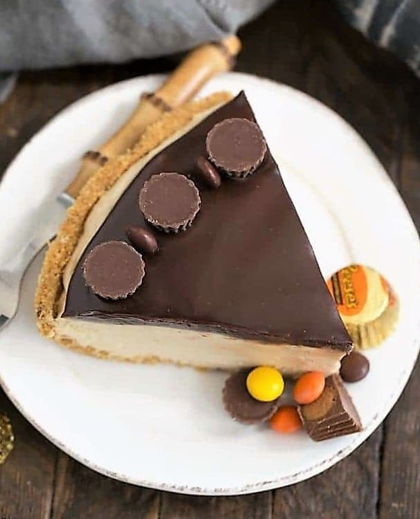 Overhead view of a slice of Frozen Chocolate Peanut Butter Pie on a white plate