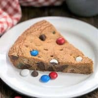 A wedge of Patriotic Skillet Cookie on a white enamel plate