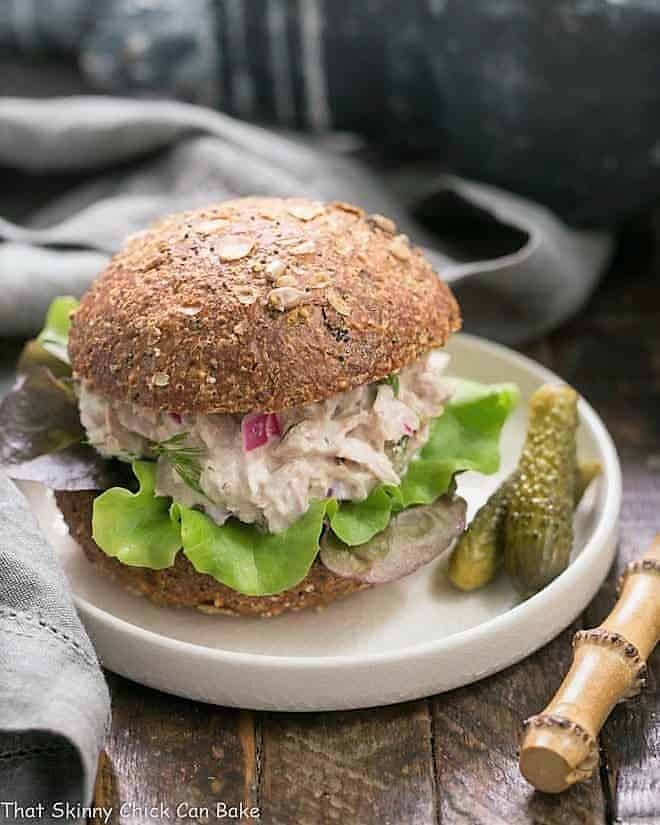 Easy Tuna Salad with Fresh Dill on a white plate with cornichons