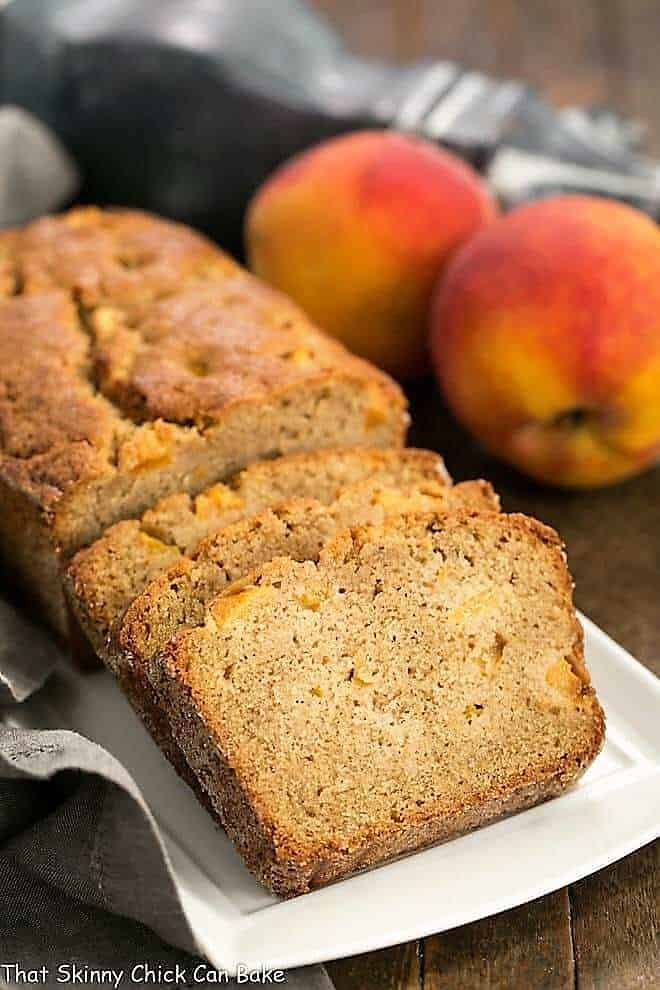Fresh Southern Peach Bread sliced on a white rectangular tray