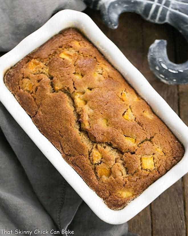 Fresh Southern Peach Bread in a white ceramic loaf pan