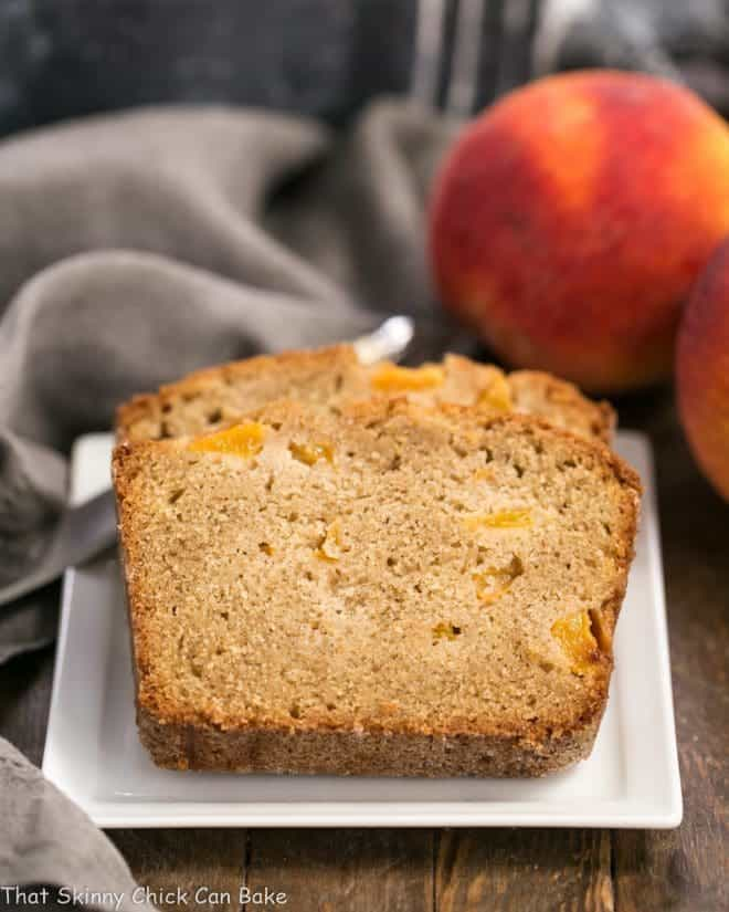 Fresh Southern Peach Bread slices on a square, white ceramic plate