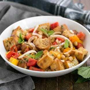 Summer Tomato and Burrata Panzanella Salad in a white ceramic serving bowl