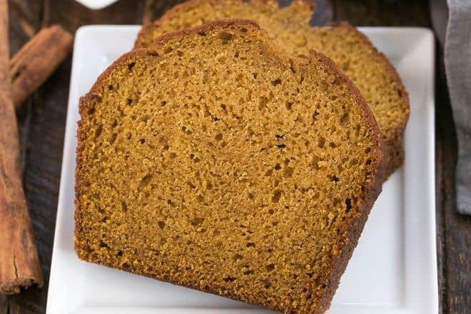 Slices of classic pumpkin bread on a square white plate