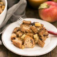 Gluten Free Apple Cinnamon Bread Pudding on a round white ceramic plate