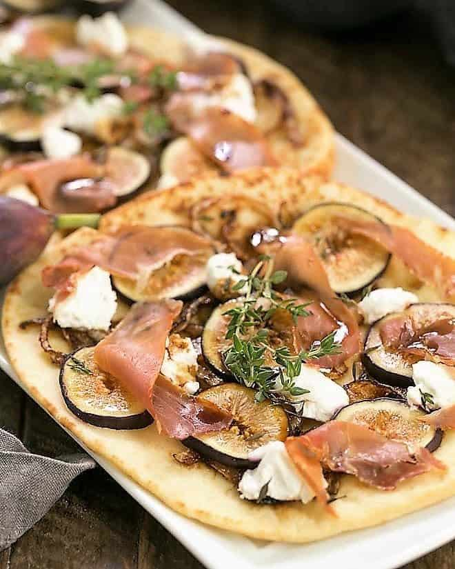 Fig, Goat Cheese and Prosciutto Pizza on a white tray