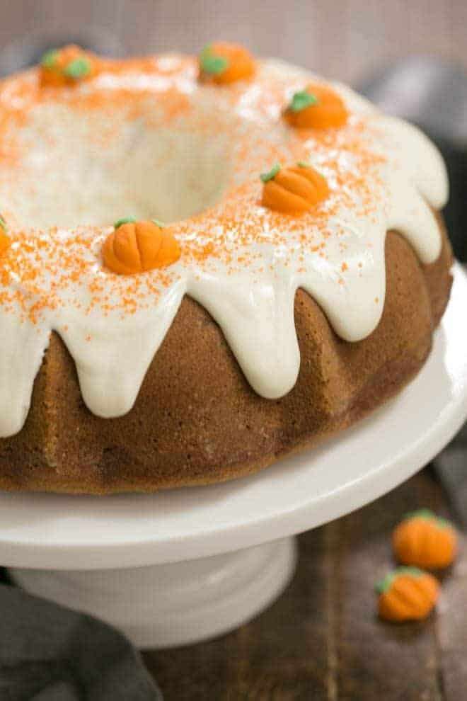 Pumpkin Spice Bundt Cake on a white ceramic cake stand