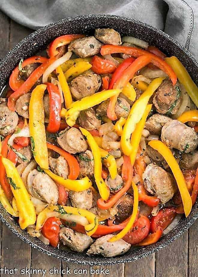 Italian Sausage and Peppers in a black skillet