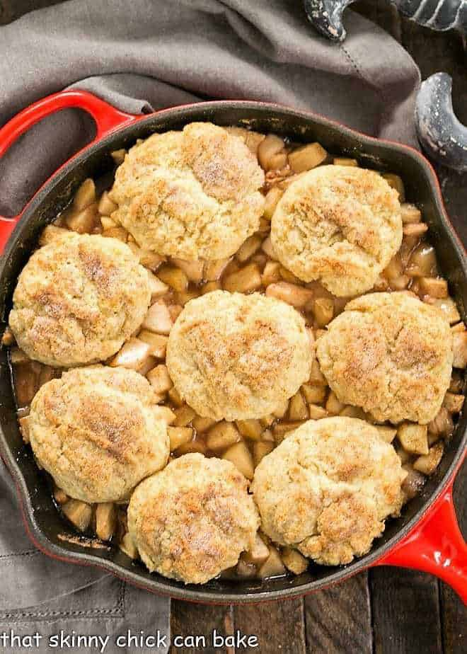 Old-Fashioned Apple Cobbler in a red cast iron skillet