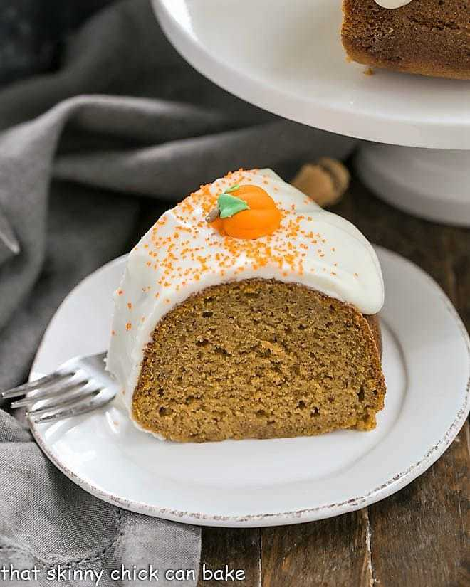 Slice of Pumpkin Spice Bundt Cake on a white dessert plate