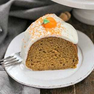 Slice of Pumpkin Spiced Bundt Cake on a white dessert plate
