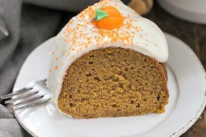 Slice of Pumpkin Spiced Bundt Cake on a white dessert plate