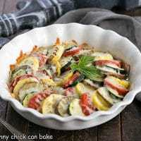 Cheesy Vegetable Tian in a white ruffled pie plate