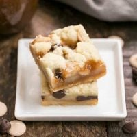 Chocolate Chip Caramel Butter Bars stacked on a small white plate