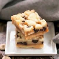 Chocolate Chip Caramel Butter Bars on a small square ceramic white plate