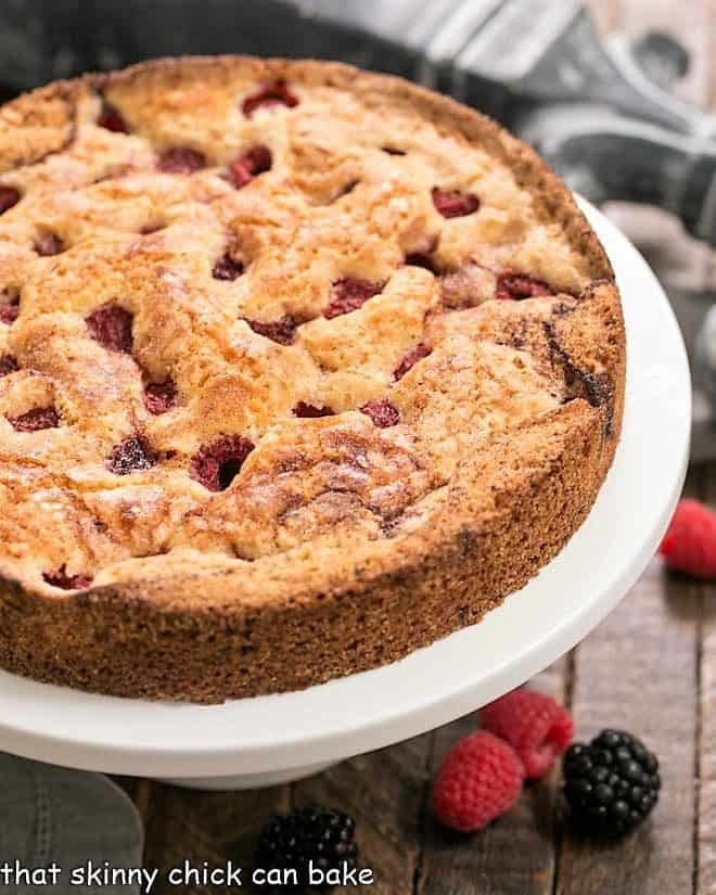 Top of a mixed berry torte with raspberries and blackberries