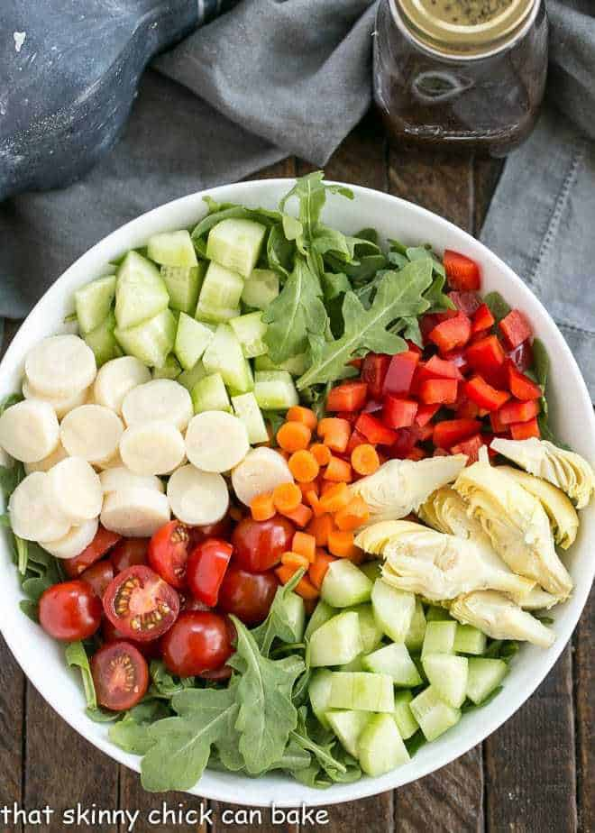 Easy Balsamic Vinaigrette next to a vegetable salad in a white bowl