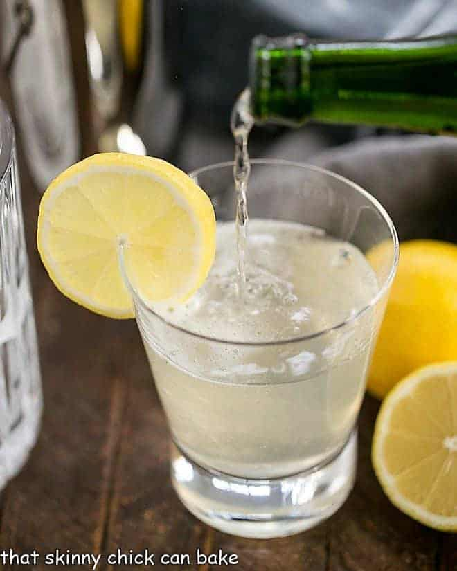 French 75 Champagne Cocktail garnished with a slice of lemon