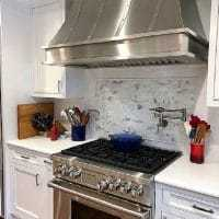Tips for Renovating a Kitchen - range and hood featured image