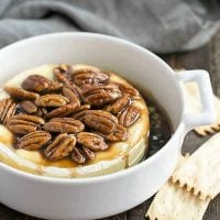 Kahlua Caramel Baked Brie in a small white casserole dish