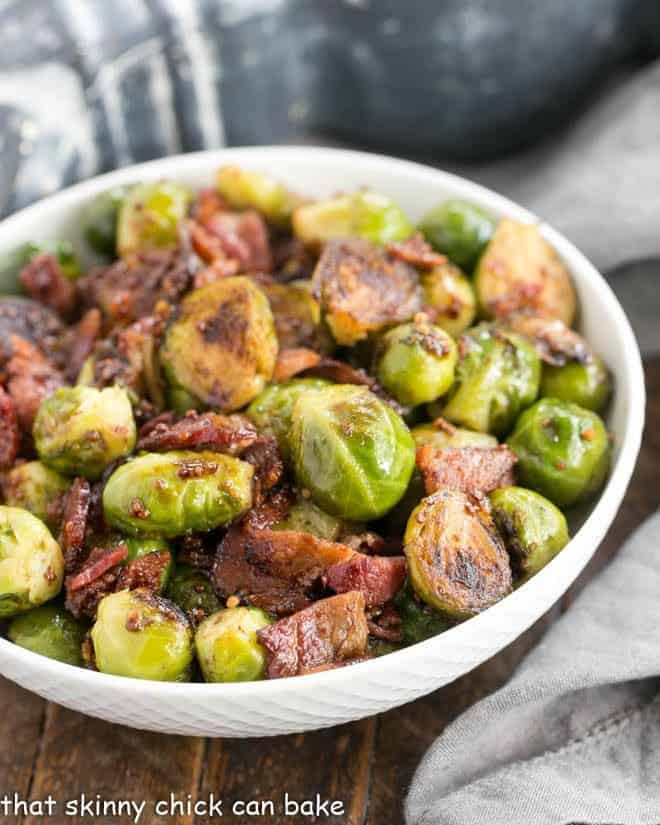 Maple Syrup Mustard Glazed Brussels Sprouts in a round white ceramic bowl