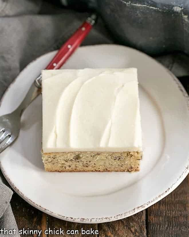 Sour Cream Banana Cake on a round white plate from above