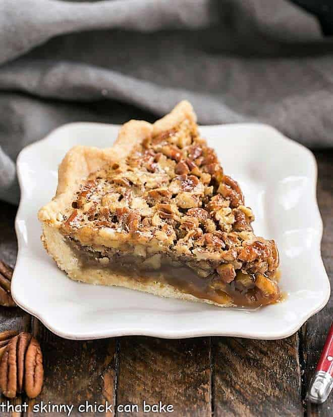 Classic Pecan Pie slice on a square white plate