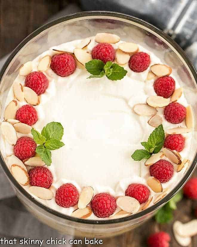 Traditional English Trifle topped with mint and fresh raspberries